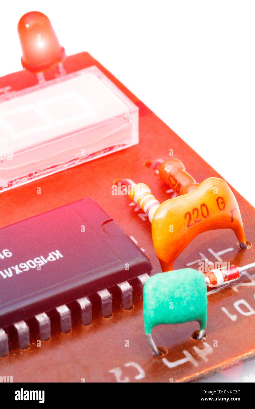 Close up of electronic components on a obsolete printed-circuit board - Stock Image