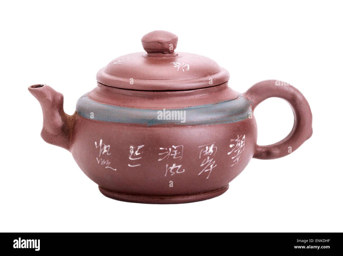 Chinese yixing ceramic handmade teapot isolated on white background - Stock Image