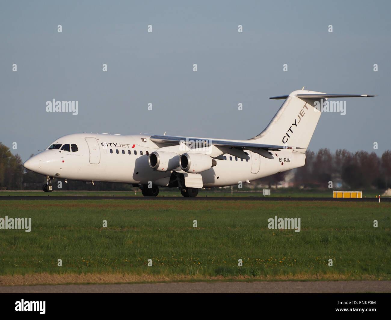 CityJet EI-RJN BAe 146 - Avro RJ takeoff from Polderbaan, Schiphol (AMS - EHAM) at sunset, - Stock Image