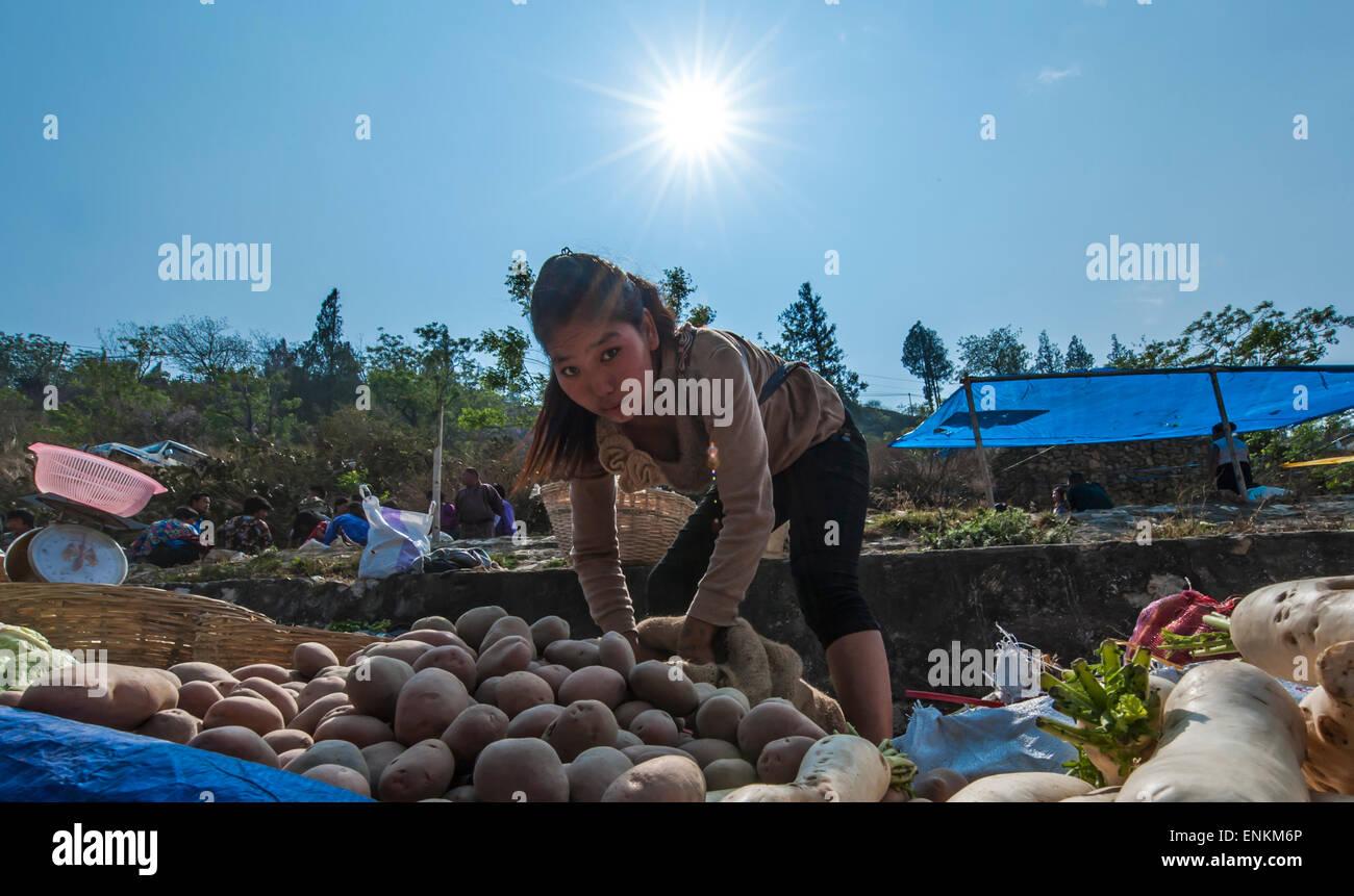Street sellers at local saturday market Punakha Buthan - Stock Image