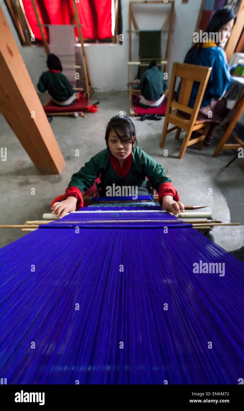 Young woman weaving tapestry at Choki traditional art school Kabesa Thimpu (country capital) Bhutan - Stock Image
