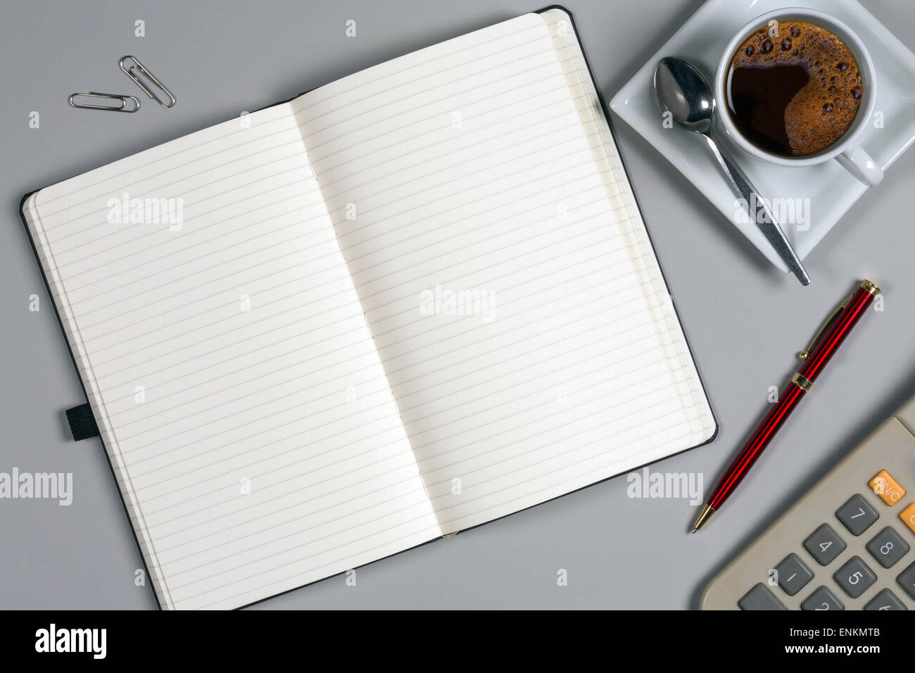 Take a memo - Notepad and coffee cup on an office worktop - Space for Text - Stock Image