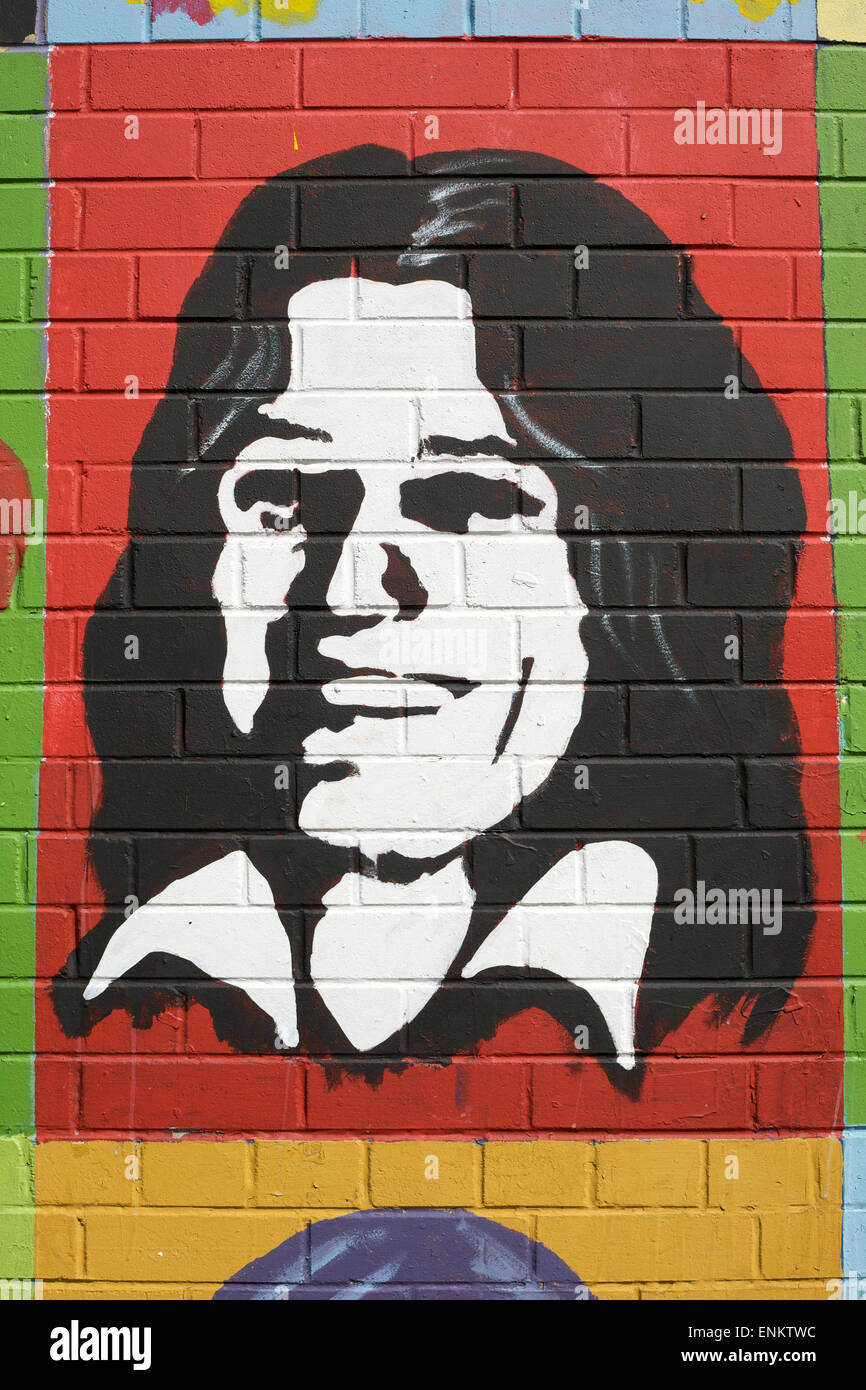 An image of Booby Sands painted onto a wall on the Falls Road in Belfast, Northern Ireland - Stock Image