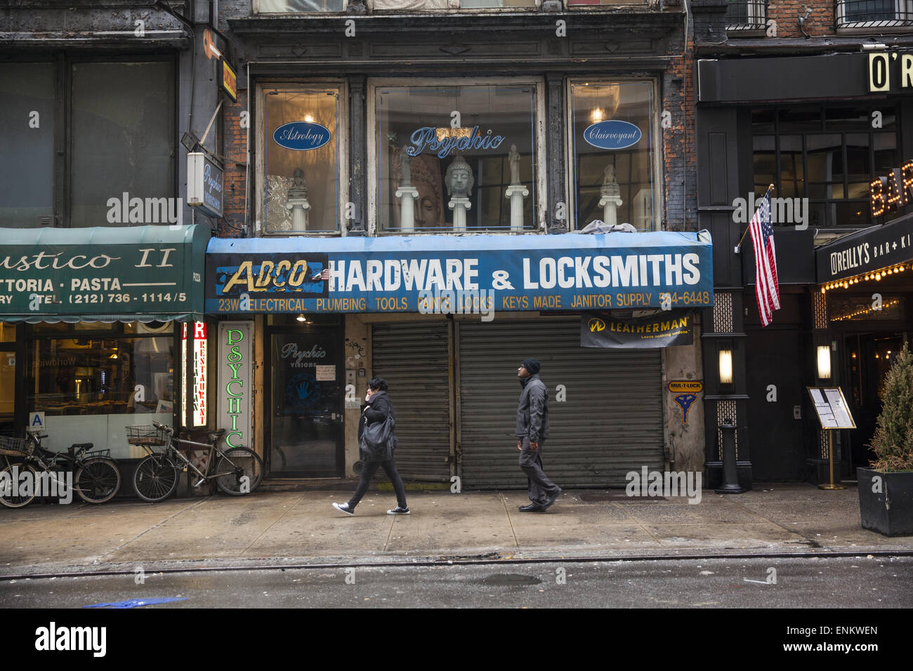 Hardware store with a psychic upstairs, West 35th Street, Manhattan, NYC. - Stock Image