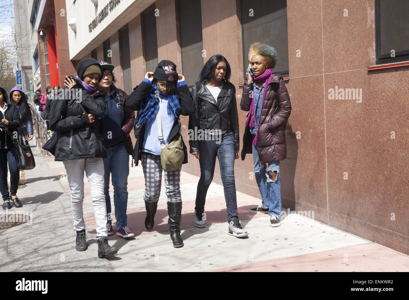 Teenage girls walking home after school in downtown Brooklyn, NY. - Stock Image
