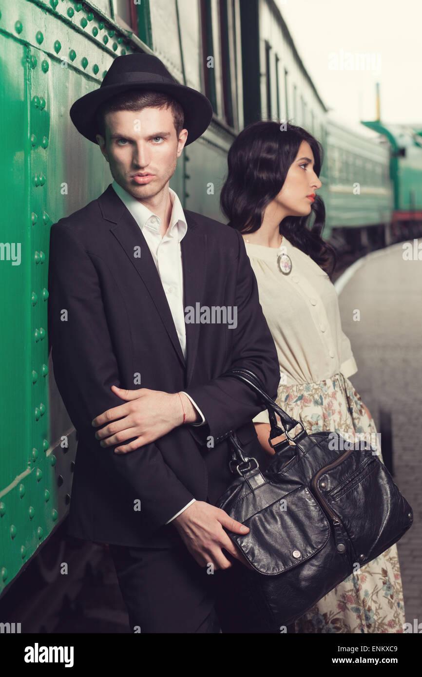 retro fashionable man at vintage railway station Stock Photo