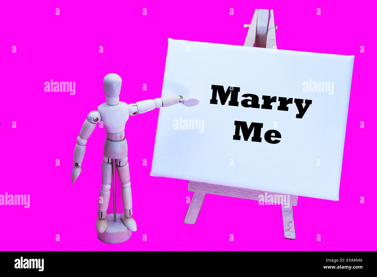 Wooden Man With White Board Pointing At Words Marry Me Proposal Proposing Declaration Of Love Marriage Asking Ask