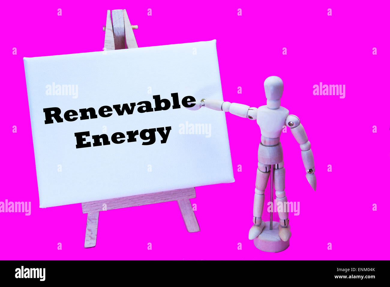 Wooden man with white board pointing at words 'renewable energy' green eco ecological electricity future - Stock Image