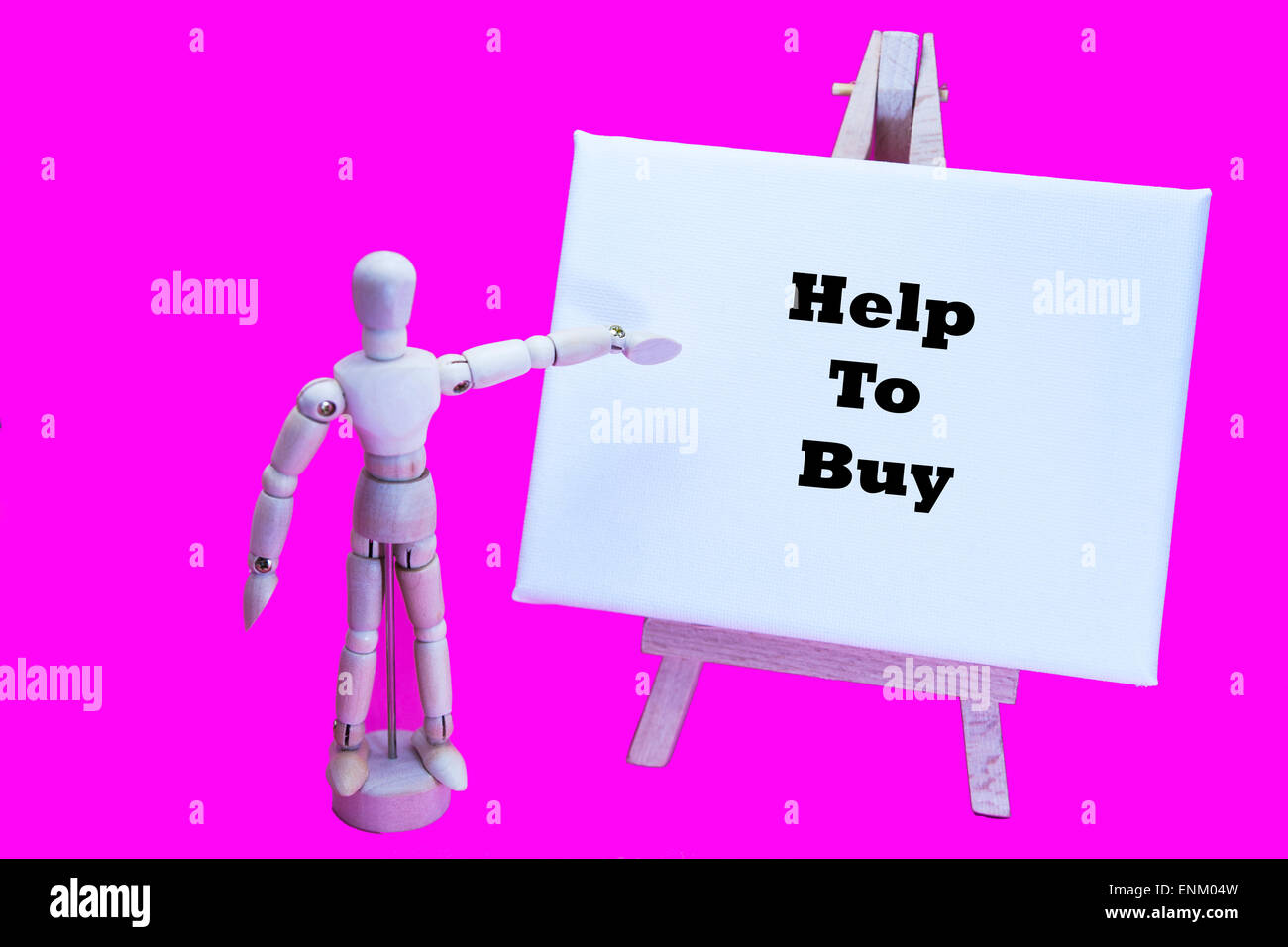 Wooden man with white board pointing at words 'Help To Buy' mortgage agreement government scheme low earners - Stock Image