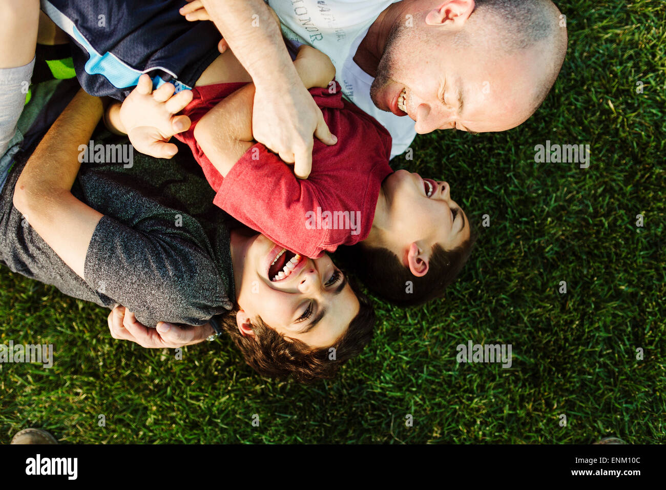 A hispanic family enjoys time together at a park in San Diego, Ca. - Stock Image