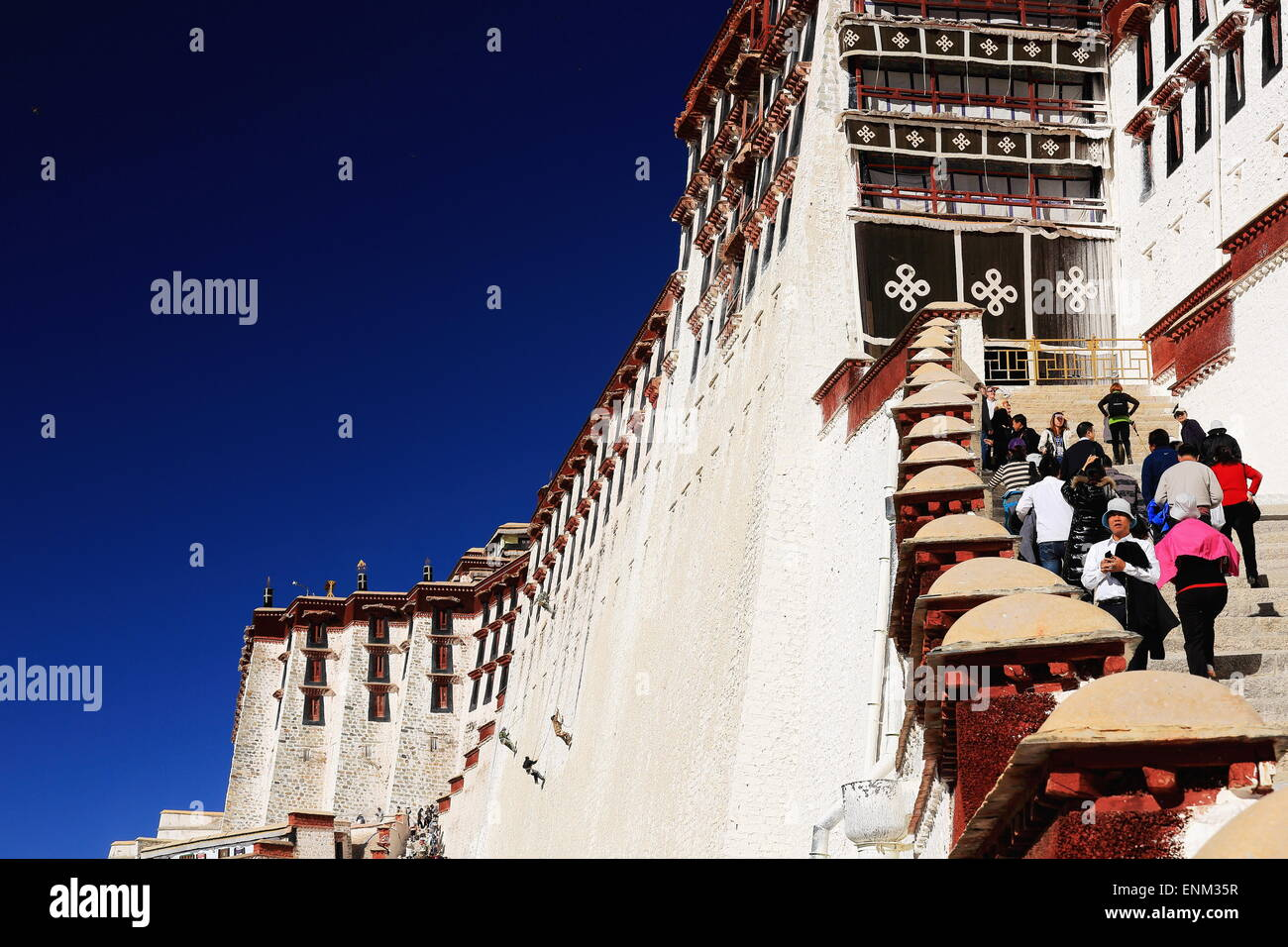 LHASA, TIBET, CHINA - OCTOBER 20: Locals and tourists climb the stairs leading to the inner Potala palace to visit - Stock Image