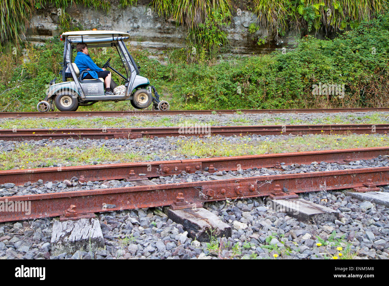 Converted golf carts on the old Forgotten World railway in New Zealand - Stock Image