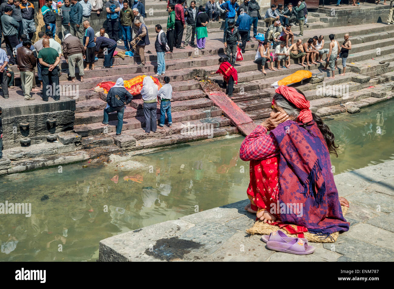 Pashupatinath Temple in Kathmandu, with cremation ghats on the banks of the Bagmati River. - Stock Image