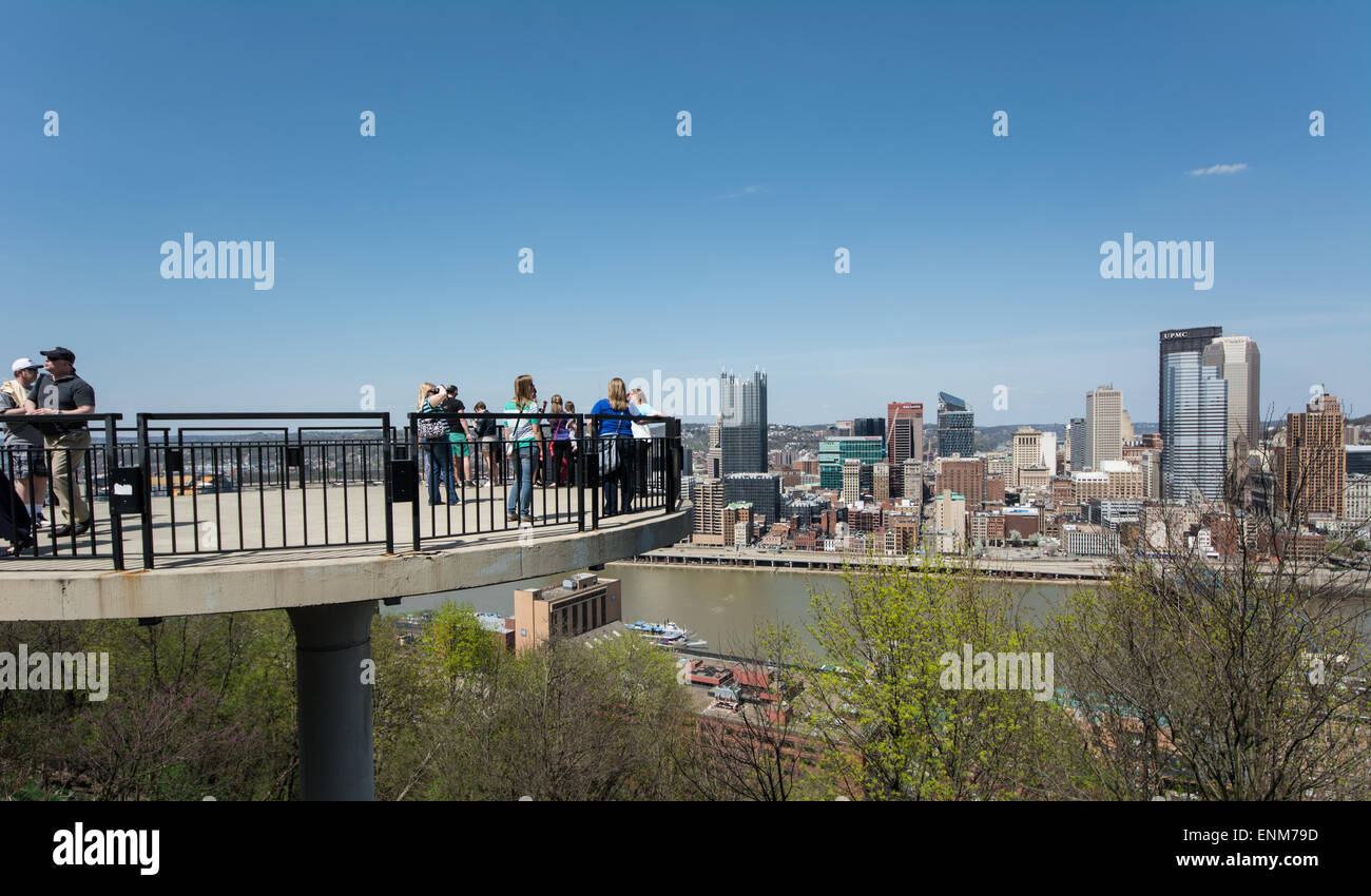 Tourists observe the Pittsburgh skyline from atop one of the observation docks on Mount Washinton. - Stock Image