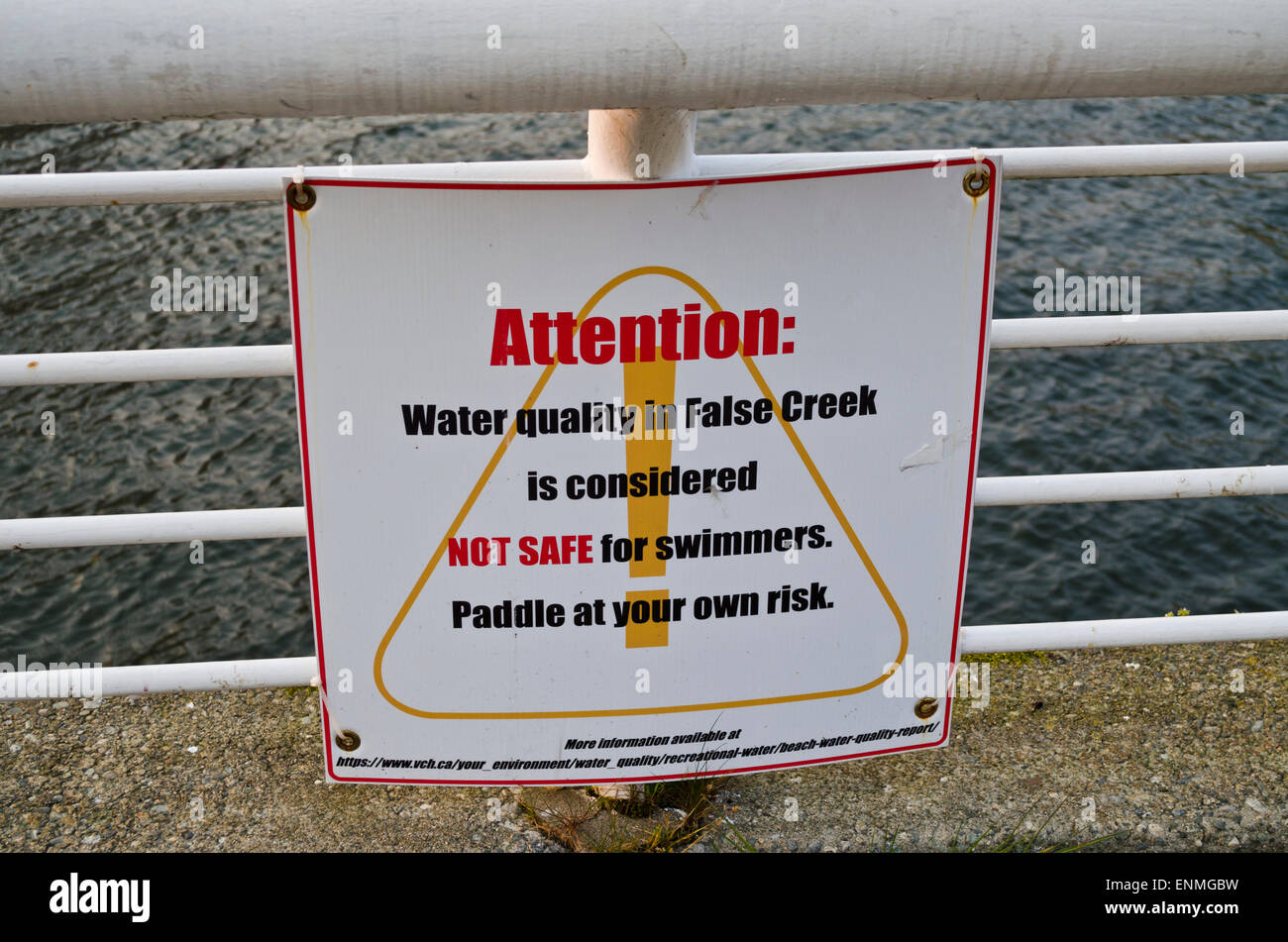 A sign warning it is not safe for swimming in the waters of False Creek in Vancouver.  Paddlers / rowers are also - Stock Image