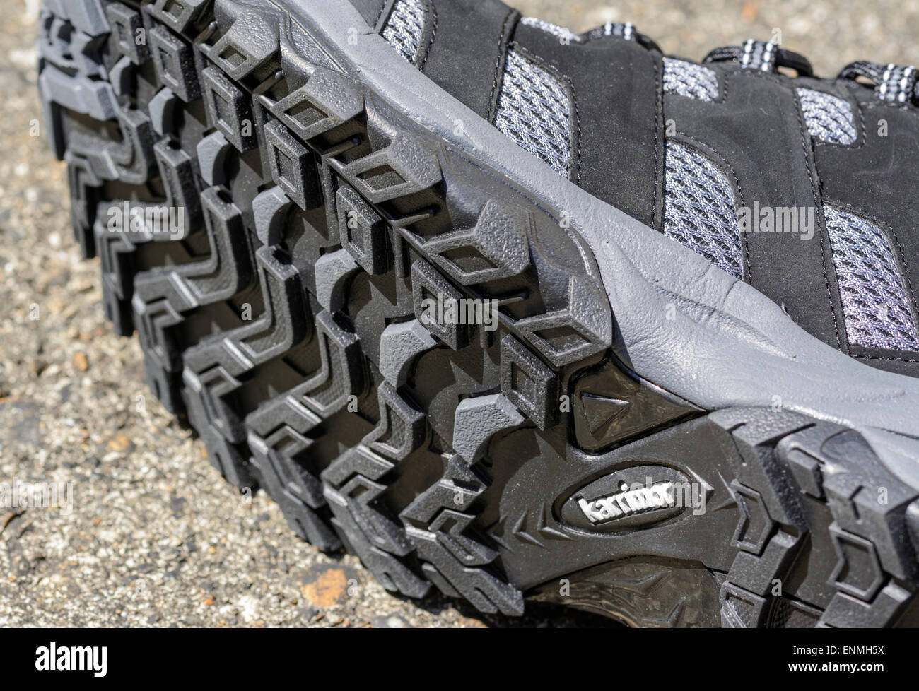 Closeup of the underside of a Karrimor training shoe on the ground. - Stock Image