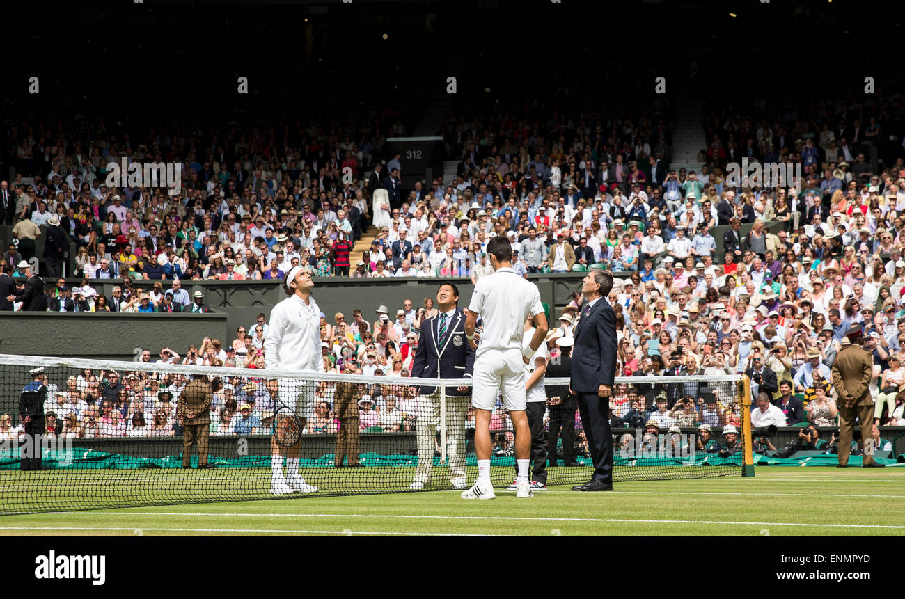 Novak Djokovic and Roger Federer during the coin toss for the Mens singles final  The Championships Wimbledon 2014 - Stock Image