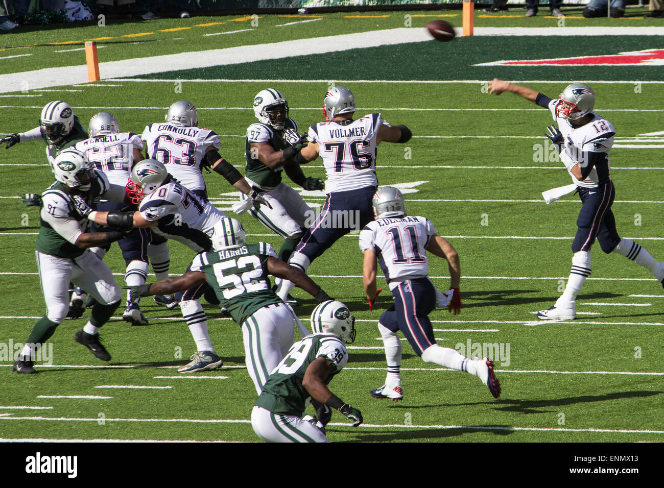 Tom Brady- New England Patriots quarterback completes a pass-play during a 2014 regular season match-up vs. the - Stock Image