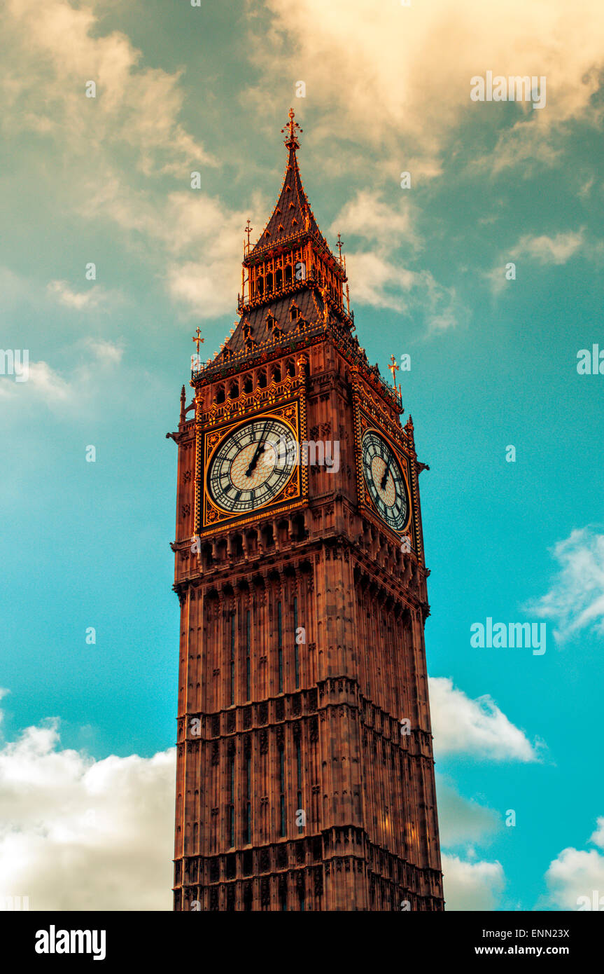 a view of the iconic Big Ben in London, United Kingdom, against a cloudy sky - Stock Image