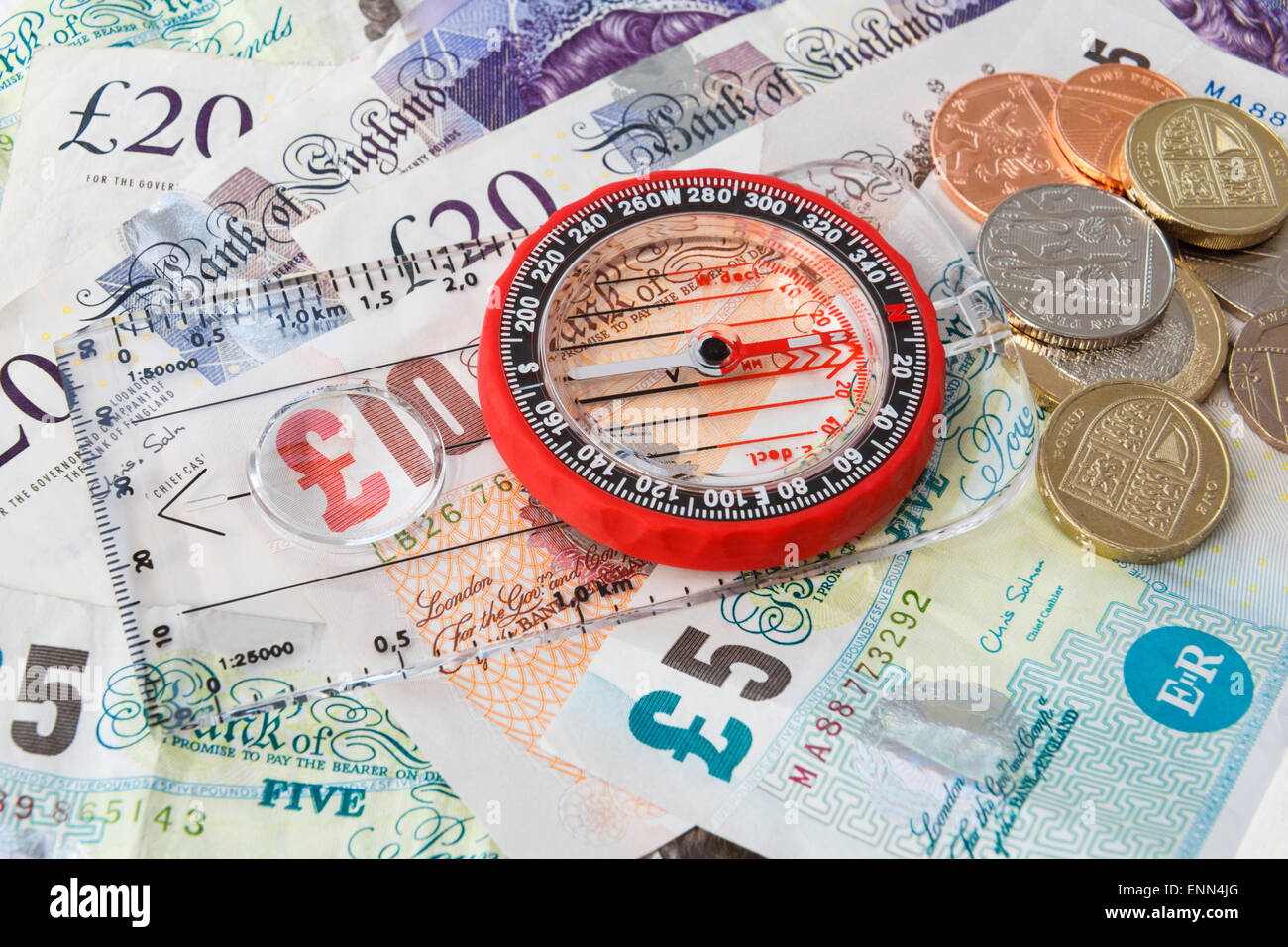 Sterling money with a compass pointing south to illustrate the direction of British economy, finance concept. England Stock Photo