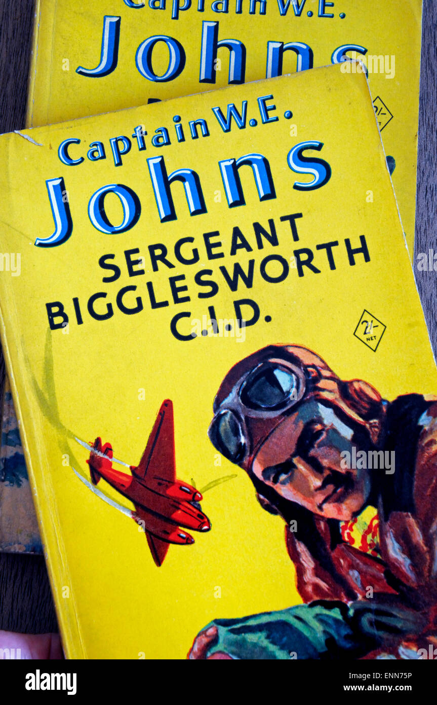 Two well used Biggles paperback books, including Sergeant Bigglesworth C.I.D. by Captain W E Johns. Editorial use - Stock Image