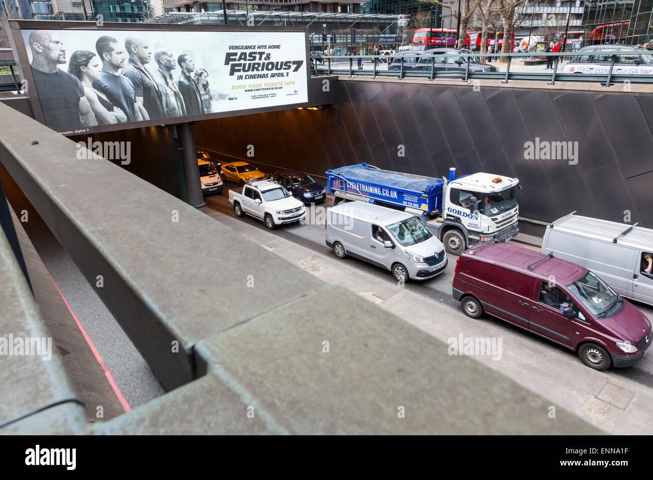 City traffic congestion. Unintentional ironic advertising above a traffic jam on Euston Road, London, England, UK - Stock Image