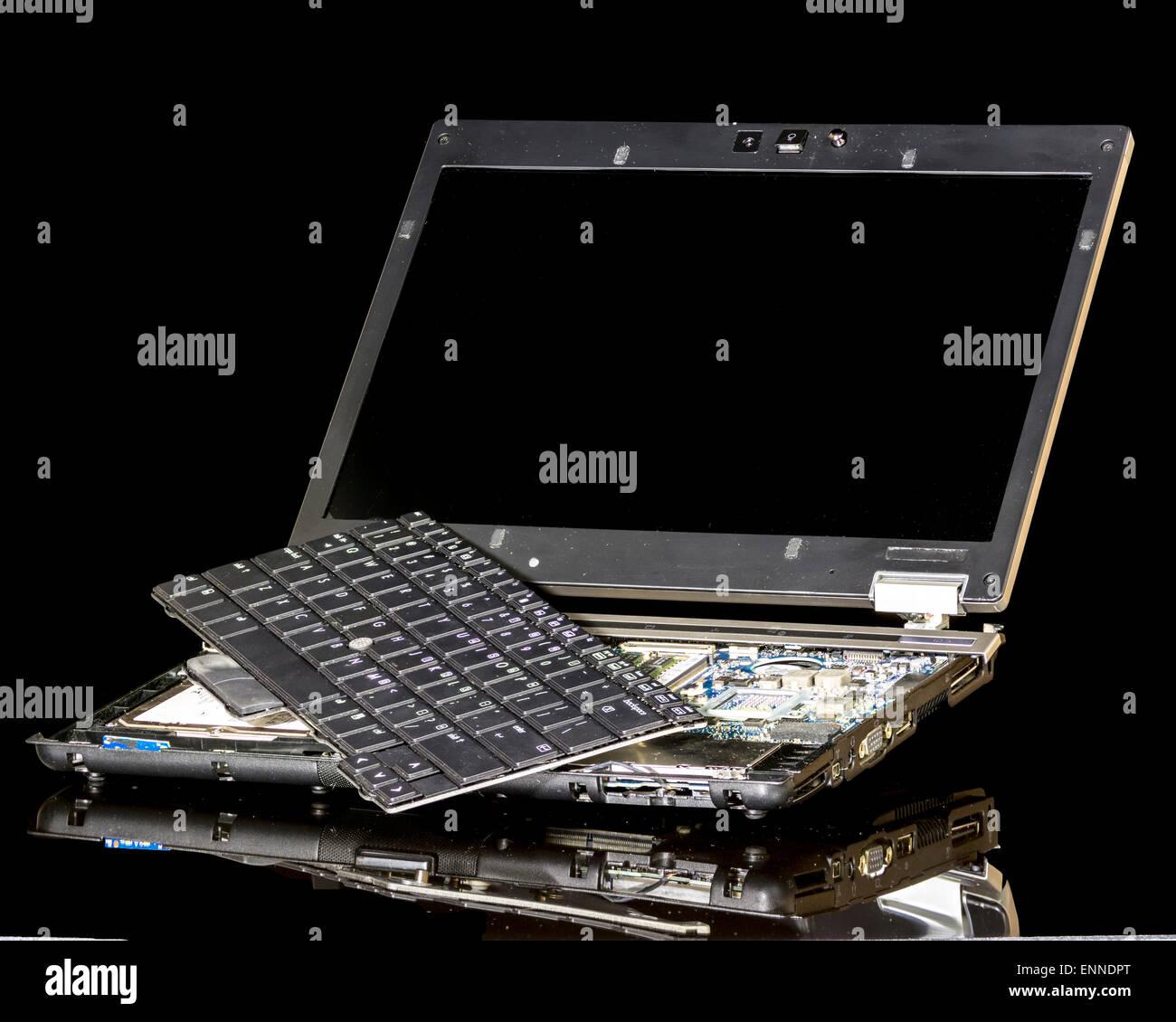 Laptop computer taken apart in pieces - Stock Image
