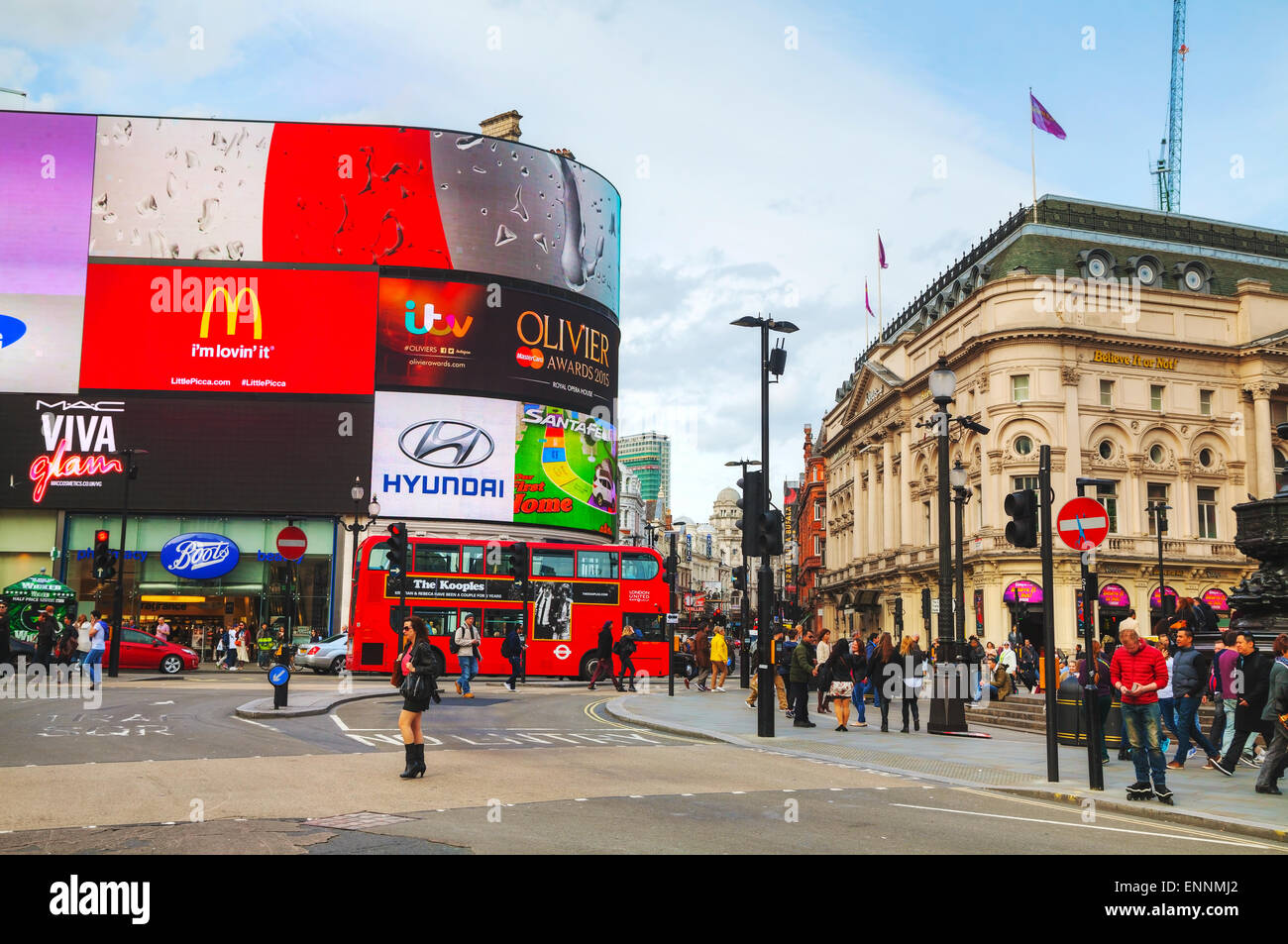 LONDON - APRIL 12: Piccadilly Circus junction crowded by people on April 12, 2015 in London, UK. - Stock Image