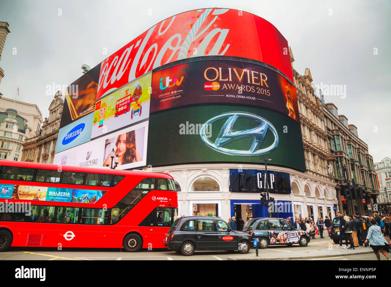 LONDON - APRIL 13: Piccadilly Circus junction crowded by people on April 13, 2015 in London, UK. - Stock Image