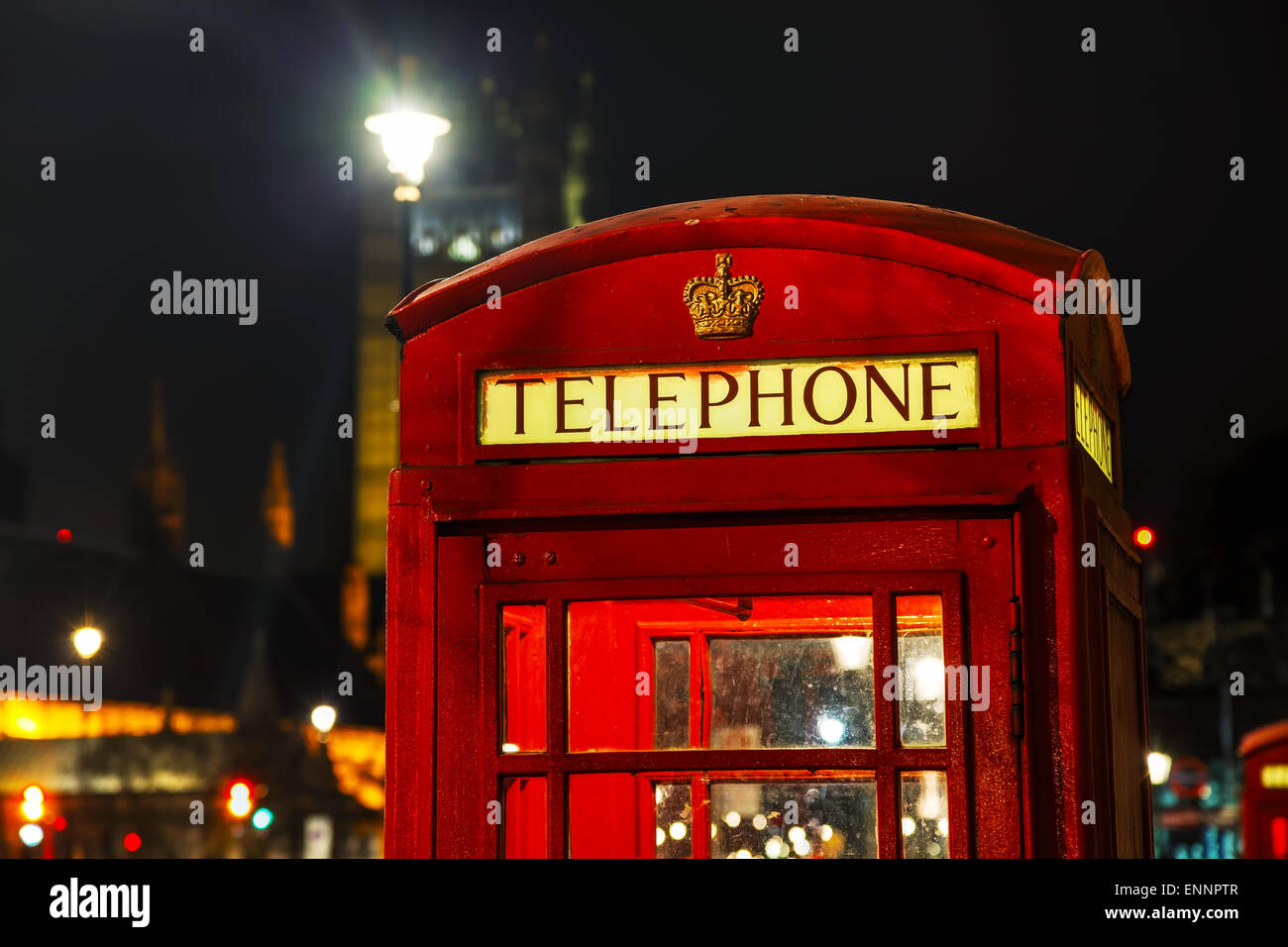 Famous red telephone booth in London, UK at night - Stock Image