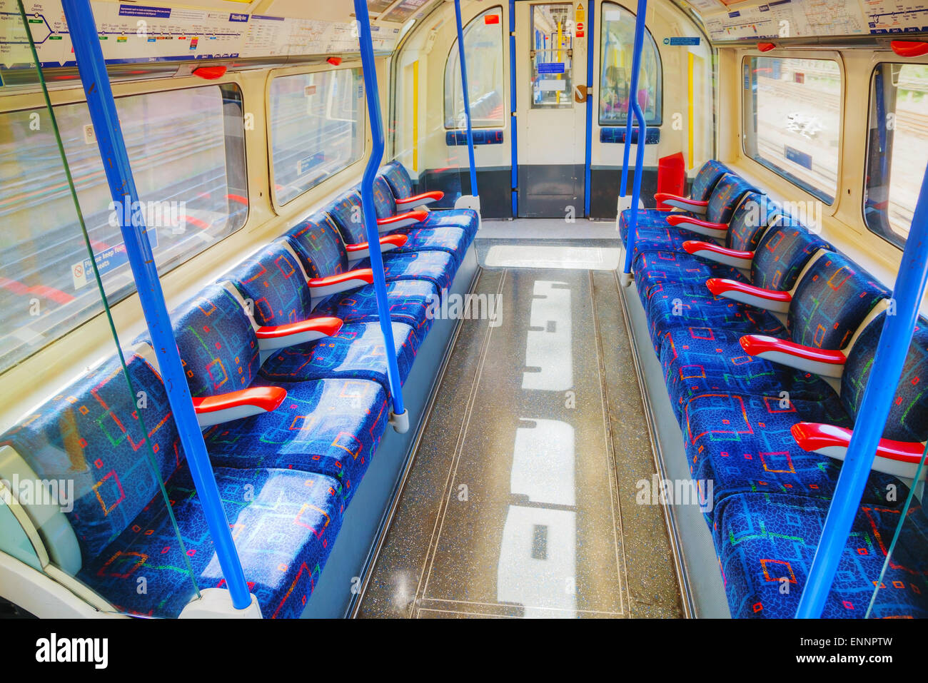 LONDON - APRIL 15: Interior of the underground train car on April 15, 2015 in London, UK. The system serves 270 Stock Photo