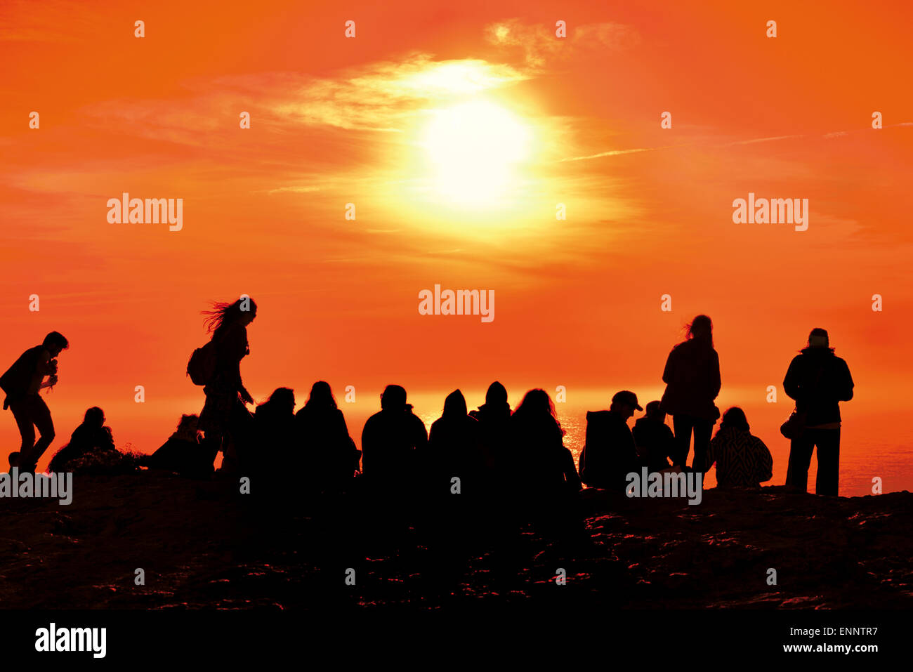 Portugal, Algarve: Tourists watching scenic sunset at Cape St. Vincent Stock Photo