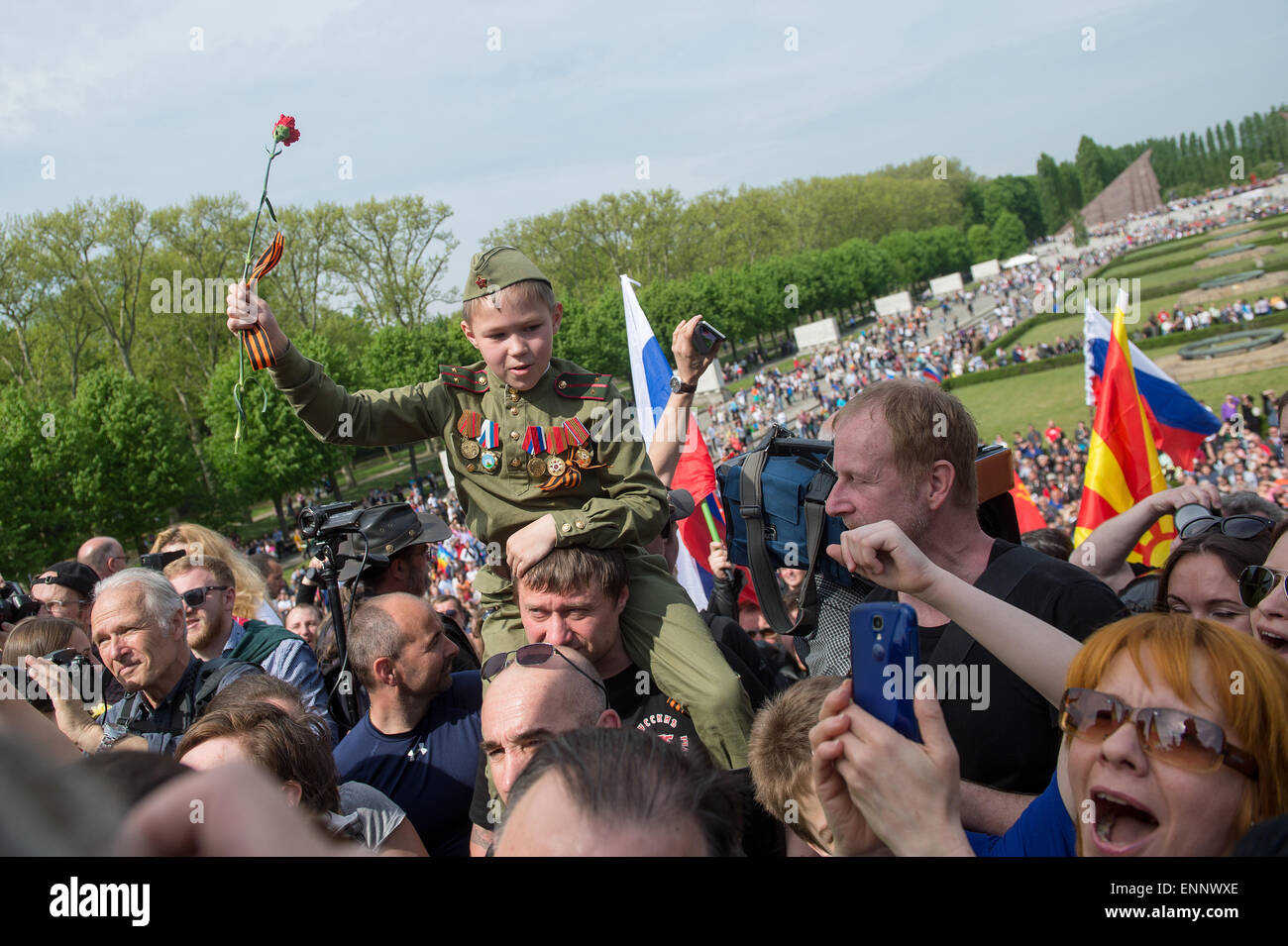 People gather at the Soviet Memorial in Treptower Park to commemorate the end of the war, Berlin, 8 May 2015. The Stock Photo