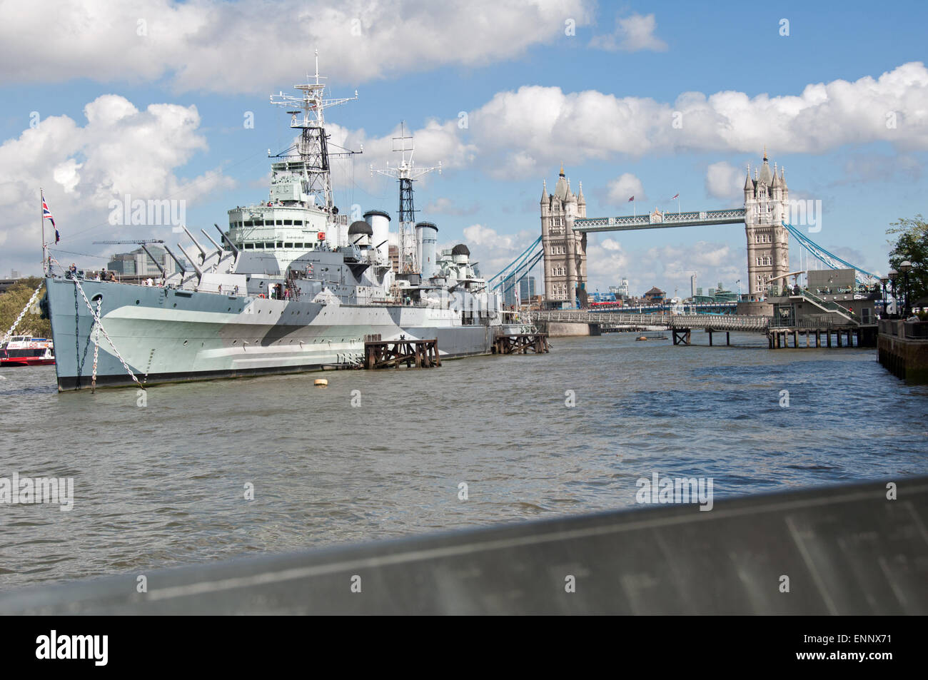HMS Belfast Ship Museum and the Tower Bridge at the background, London, U.K. - Stock Image