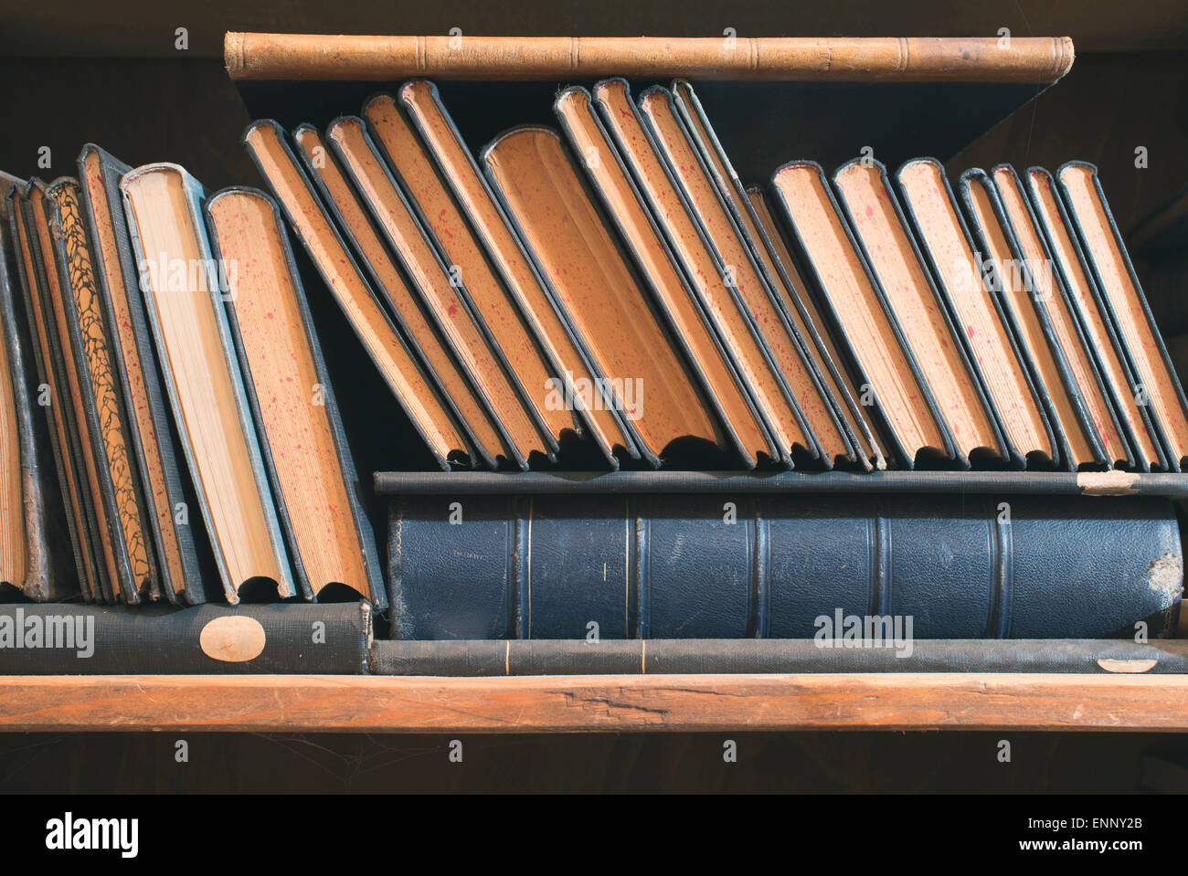 Old books in a vintage library shelves - Stock Image