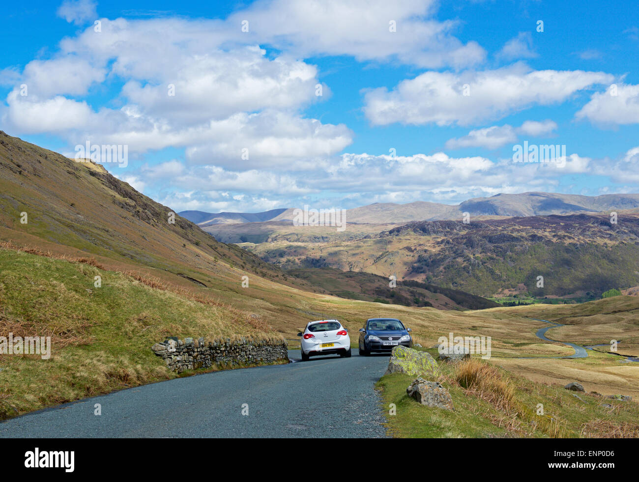Two cars passing on the narrow Honister Pass, Lake District National Park, Cumbria, England UK - Stock Image