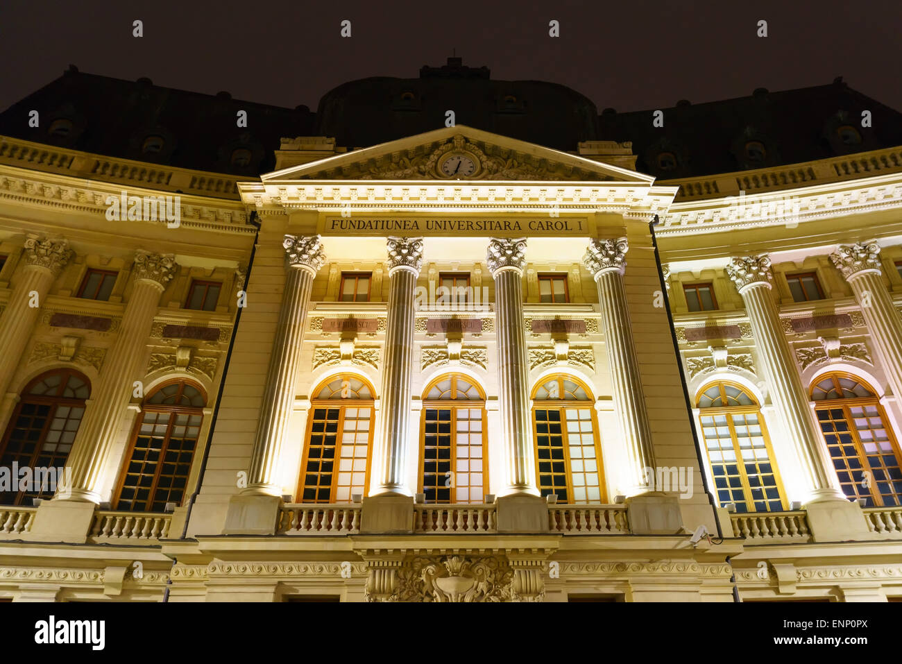 The university library at night in Bucharest, Romania. - Stock Image