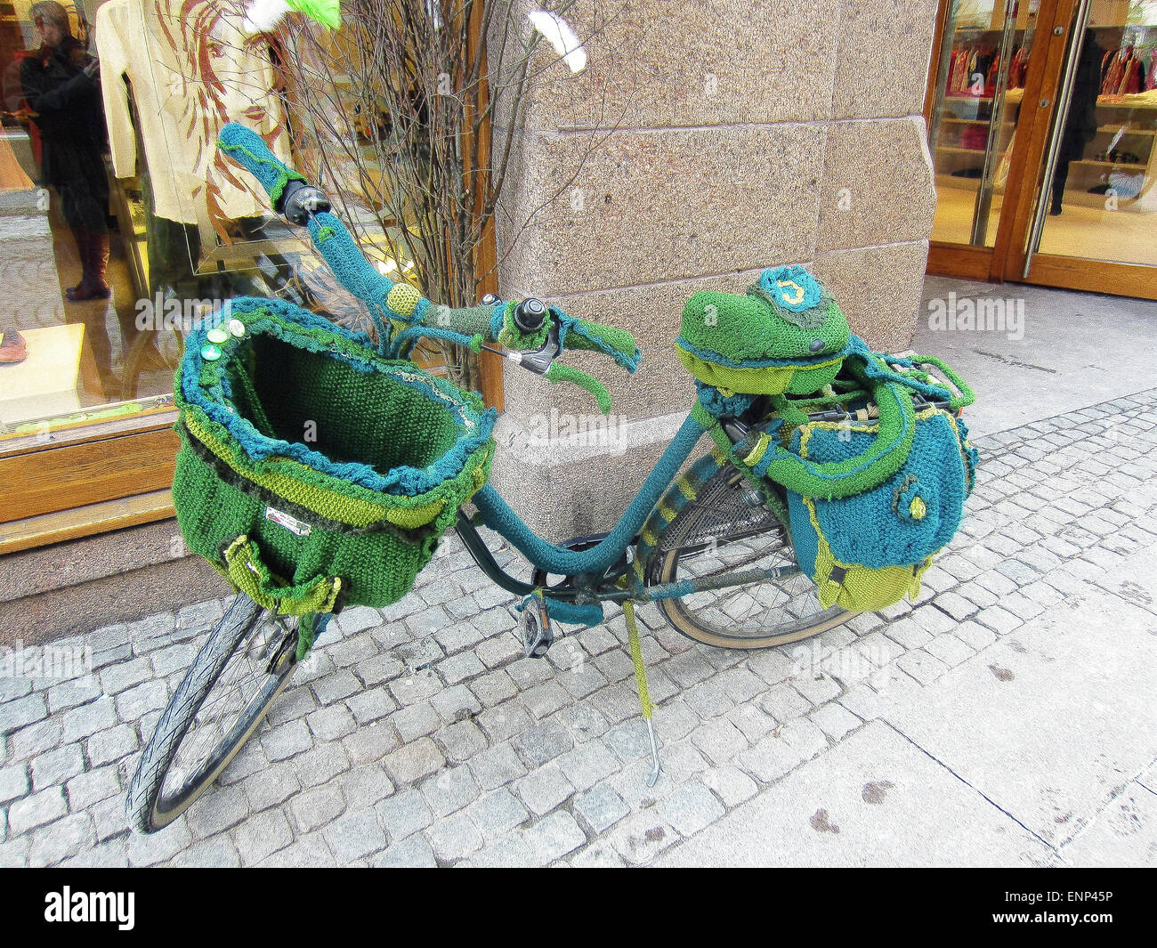 This bike was parked on a sidewalk in front of a store in Copenhagen, Denmark, in March 2013. Almost every section - Stock Image