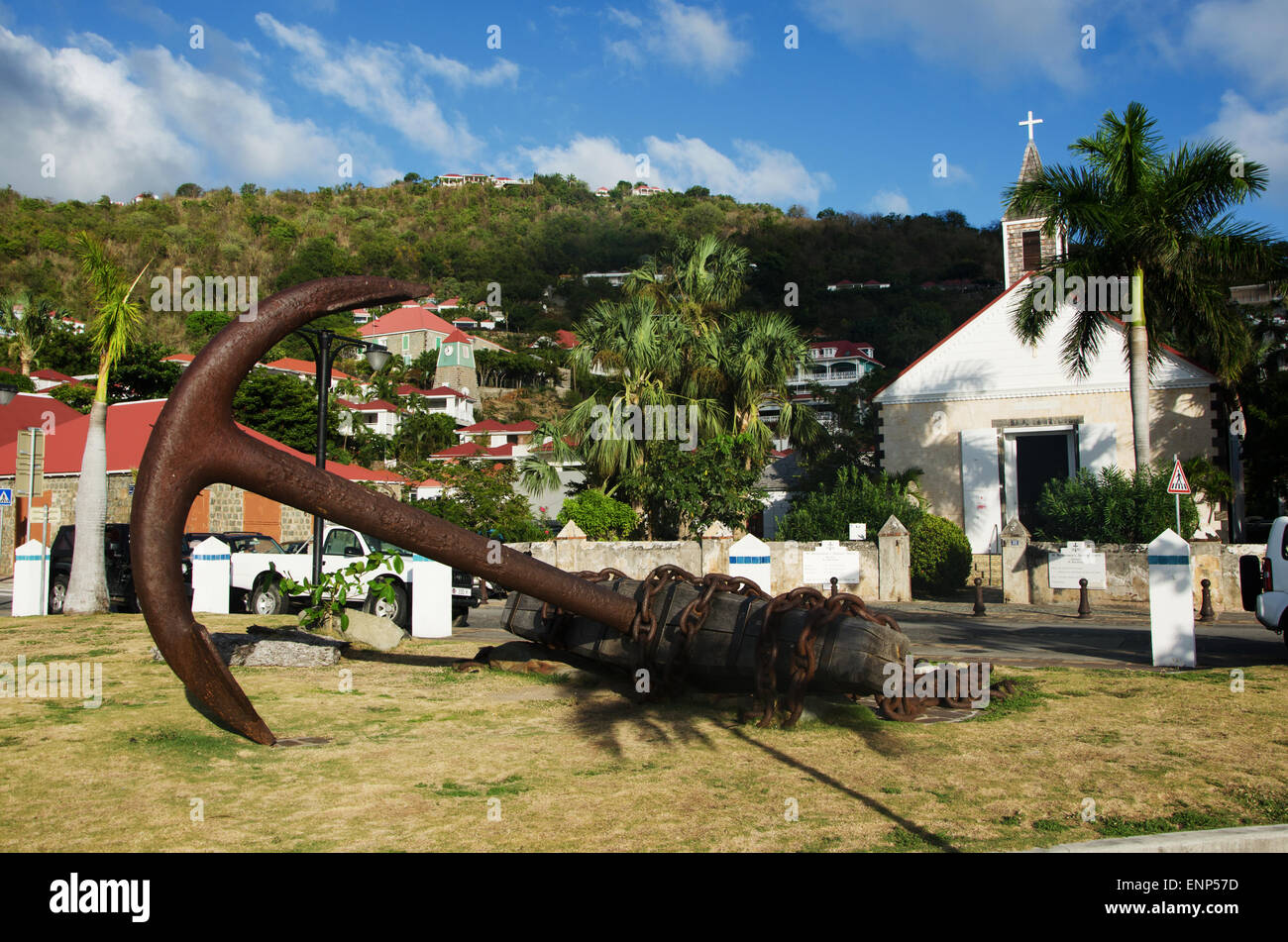 Saint-Barthélemy, French West Indies, Caribbean: a sculpture in the form of an anchor, the skyline of Gustavia and the Anglican Church Stock Photo