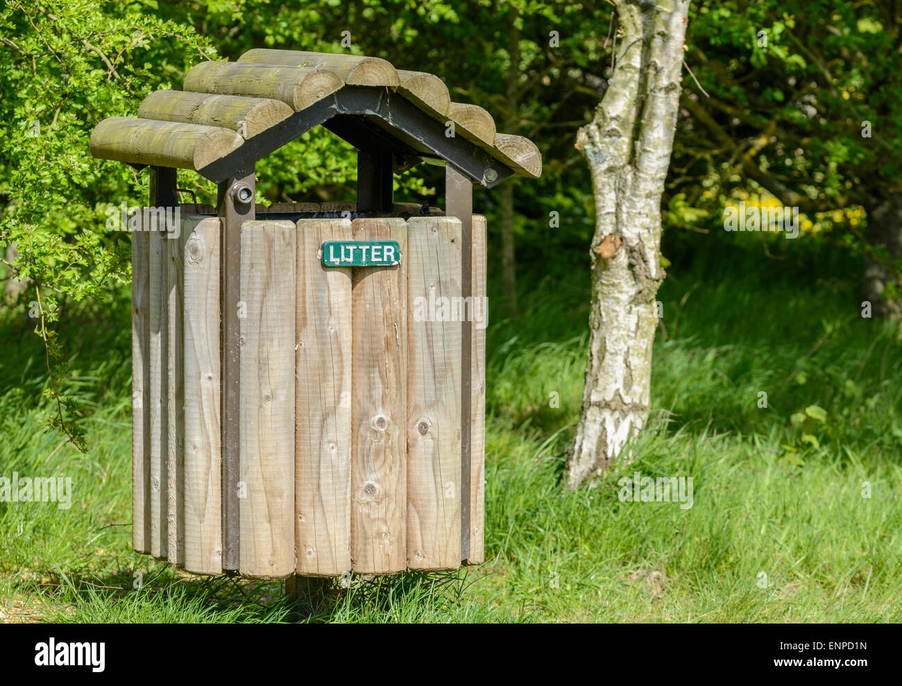 Wooden litter bin in a park. - Stock Image