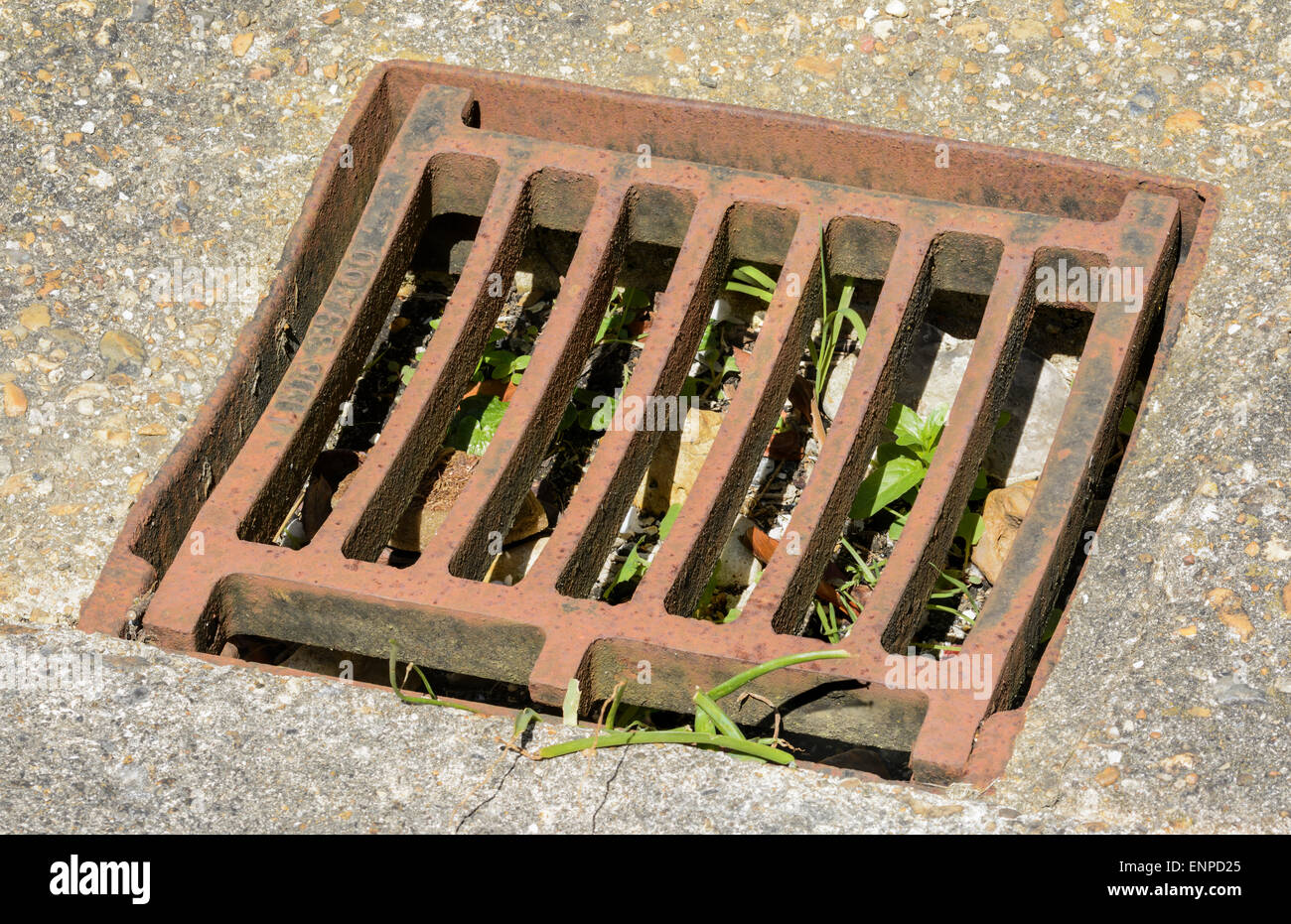 Dried up rusted metallic drain cover. - Stock Image