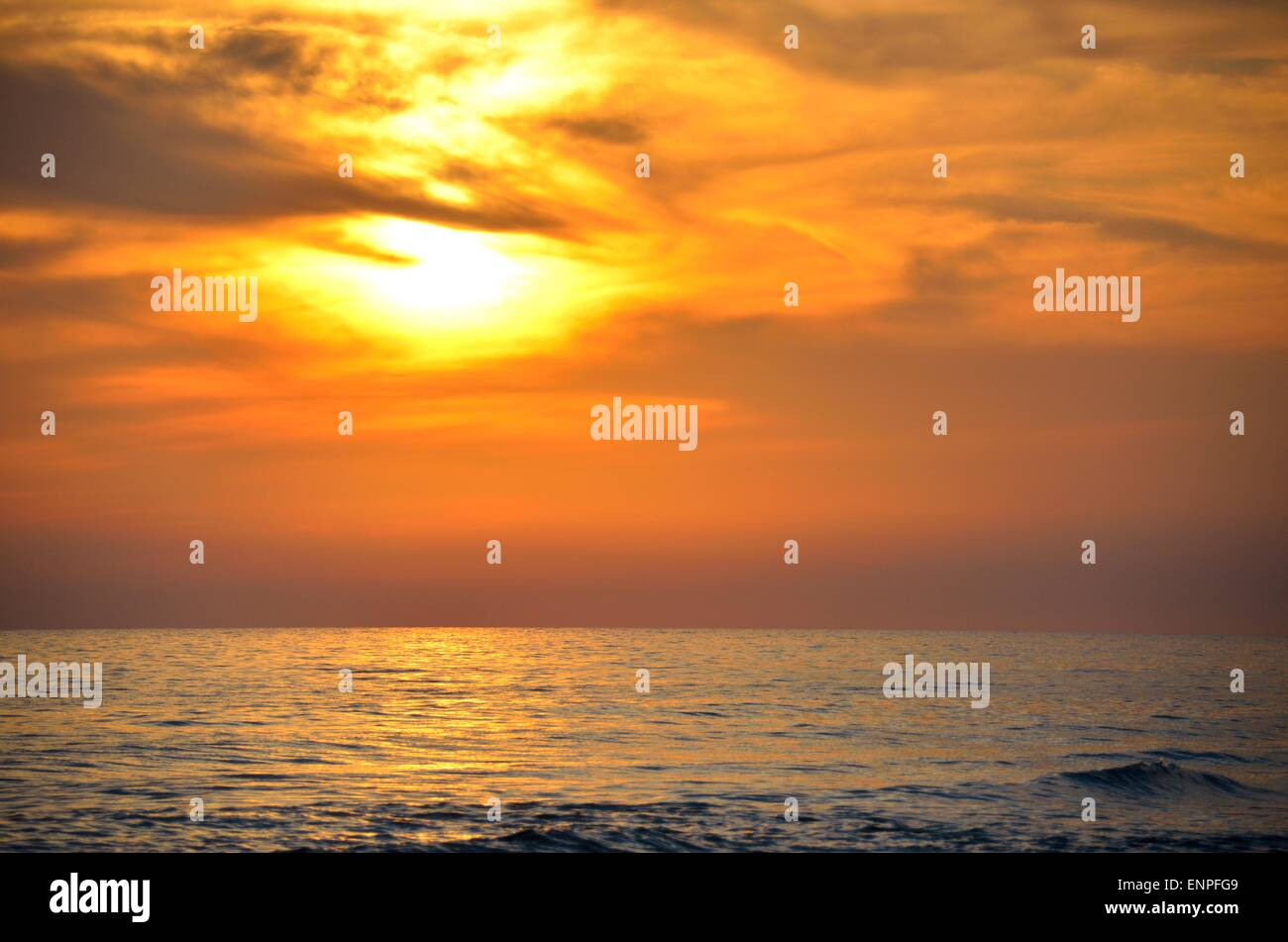 Sunset over the tropical ocean waves located at Panama City, Florida, USA Stock Photo