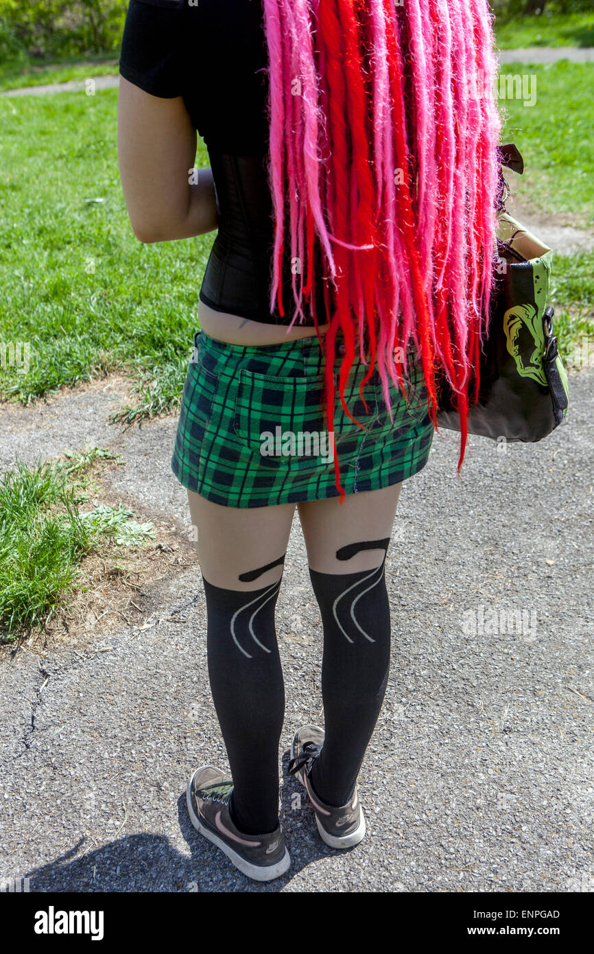 Girls in short skirts and colored dreadlocks Stock Photo