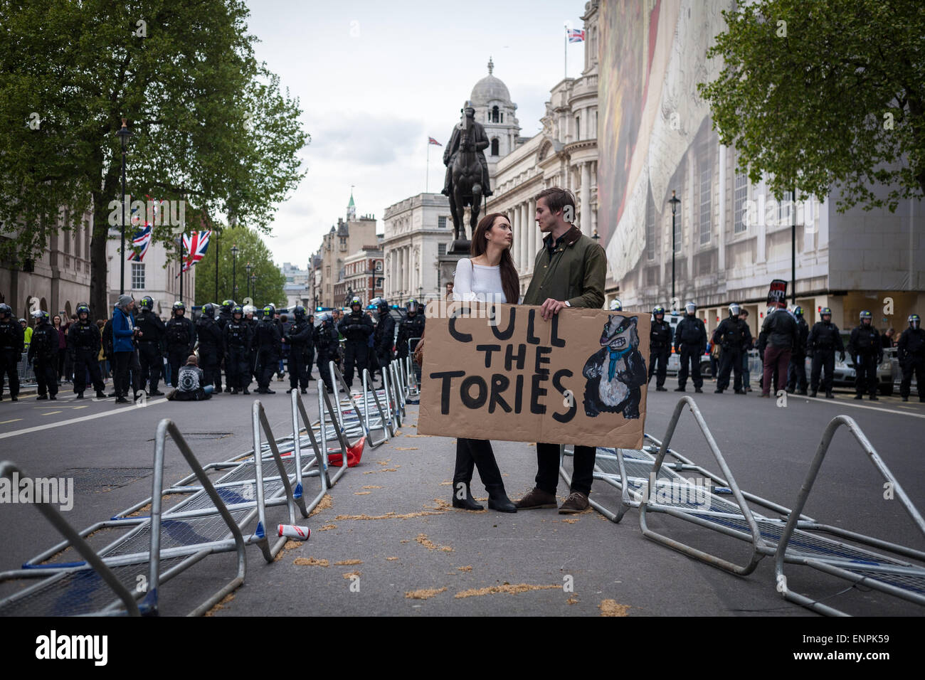 London, UK. 9th May, 2015. A pair of demonstrators hold a placard on Whitehall during an anti-Tory protest in central - Stock Image