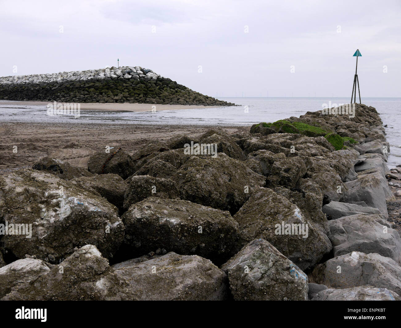Harbour breakwater at Rhos on Sea with tide marker Stock Photo