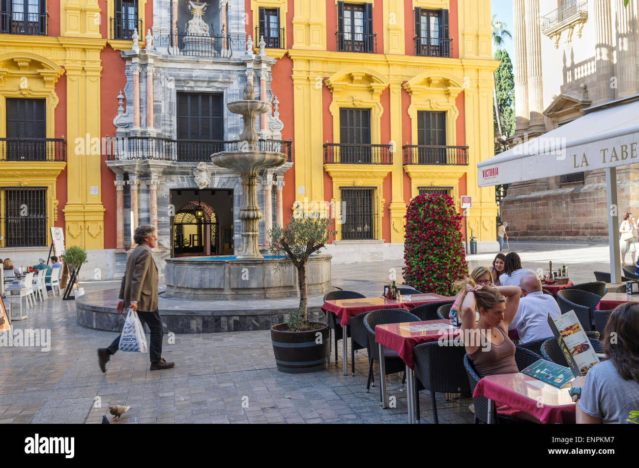 Malaga, Spain. Malaga, Spain. People sitting at a terrace by the Bishop's Palace (Palacio Episcopal) at Bishop - Stock Image