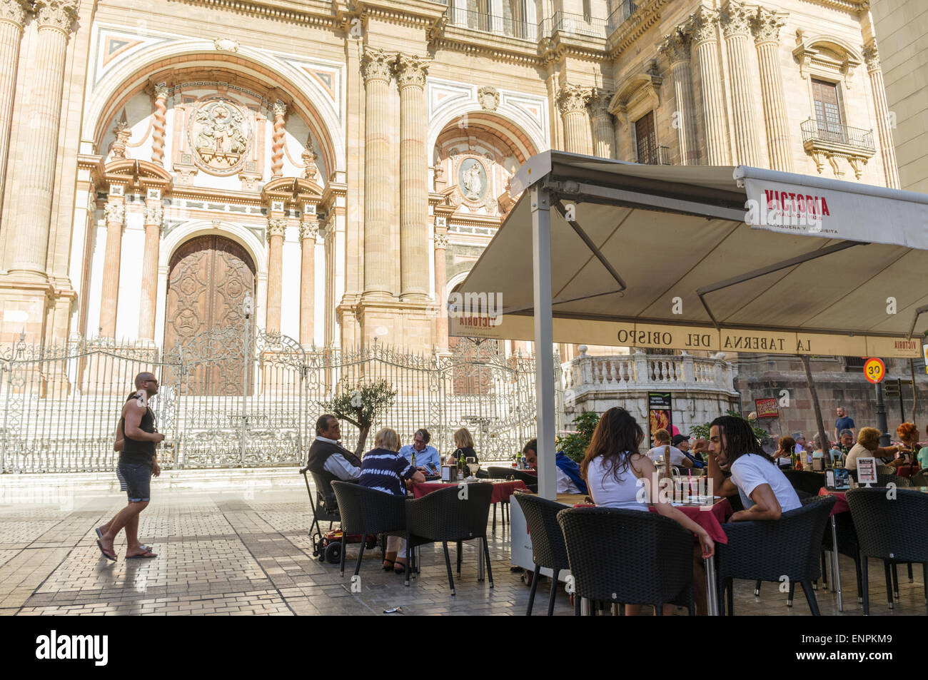 Malaga, Spain. People sitting at a terrace by the Cathedral on Bishop Square. - Stock Image