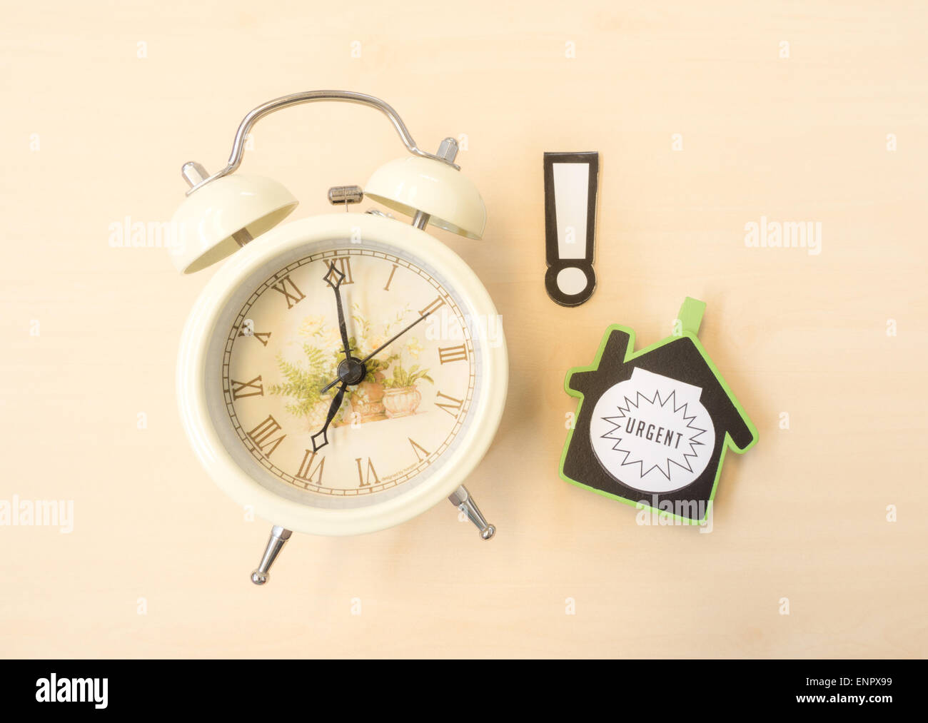 White Clock with Alert and Urgent Sign - Stock Image