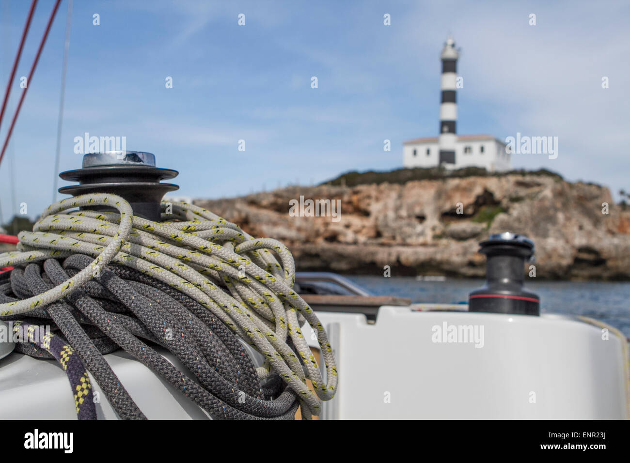 Sail lines at the boat at the background of the lighthouse at the bay of Porto Colon, Travel to Majorka - Stock Image
