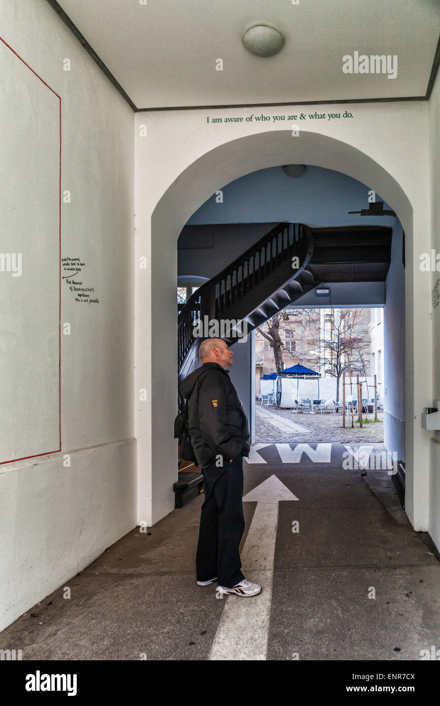 Senior man at entrance of KW Institute of Contemporary Arts Building , Auguststrasse, Mitte, Berlin - Stock Image
